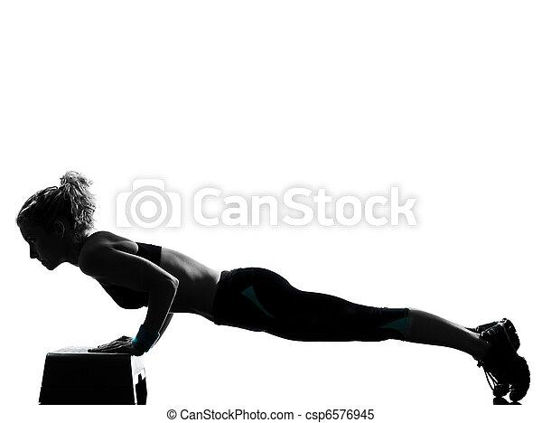 woman exercising step aerobics - csp6576945