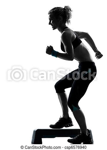 woman exercising step aerobics - csp6576940