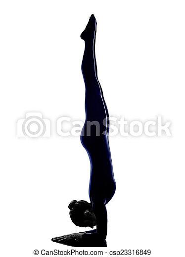 987709024c165 woman exercising vrschikasana scorpion pose yoga silhouette - csp23316849