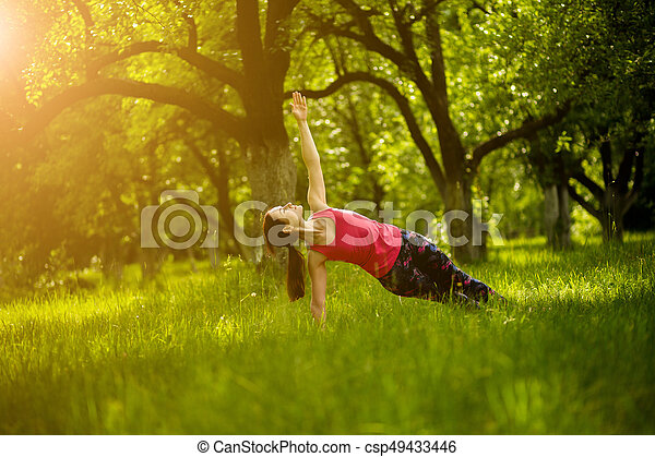 woman exercising yoga in side plank pose yoga practice