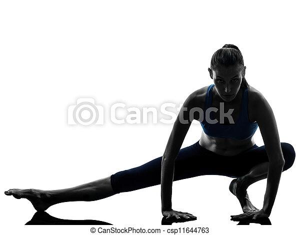 woman exercising yoga stretching legs warm up - csp11644763