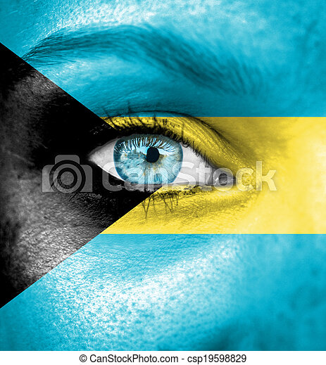 Woman face painted with flag of Bahamas - csp19598829