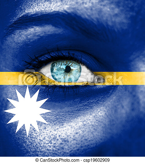 Woman face painted with flag of Nauru - csp19602909