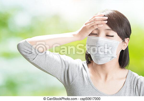 woman feel headache - csp50617000