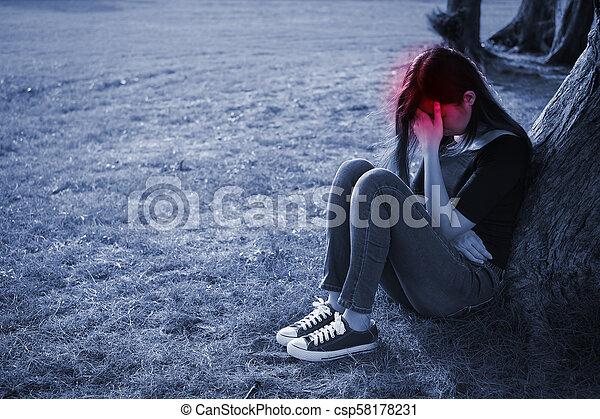 woman feel headache - csp58178231