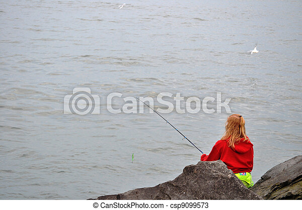 Woman fishes on Lake Erie - csp9099573