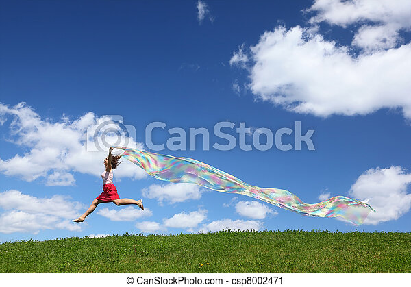 Woman flies on sky with piece of fabric in hands which develops down wind - csp8002471