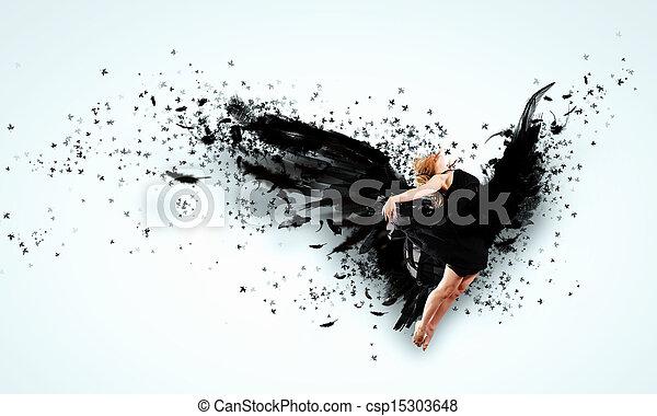 Woman floating   on dark wings - csp15303648