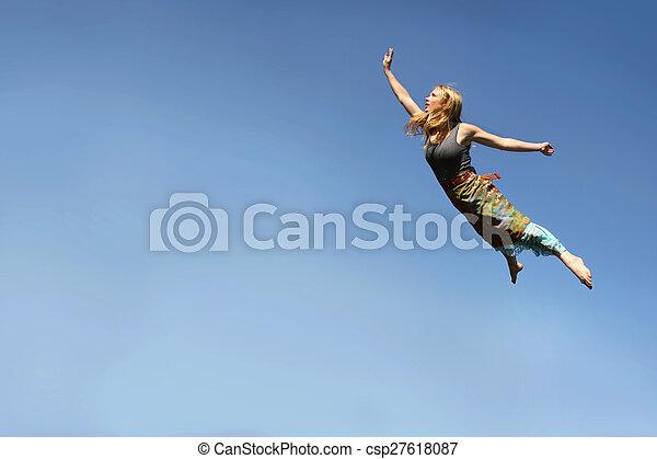 Woman Flying Through Blue Sky - csp27618087