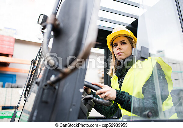 Woman forklift truck driver in an industrial area. - csp52933953