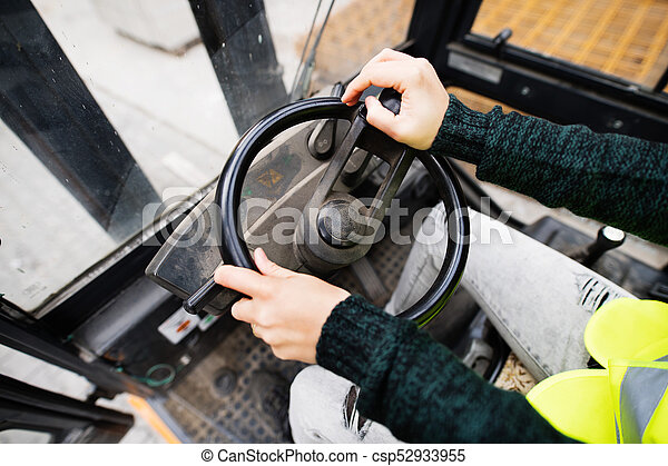Woman forklift truck driver in an industrial area. - csp52933955