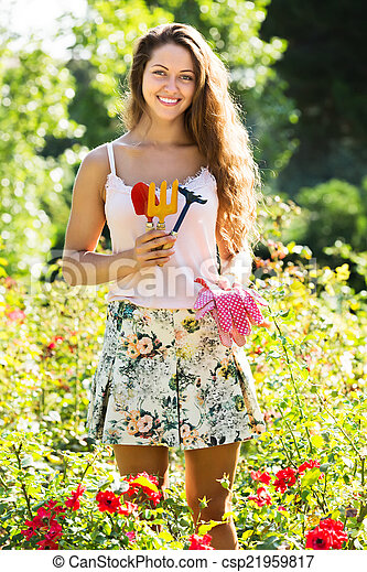 Woman gardening with roses - csp21959817