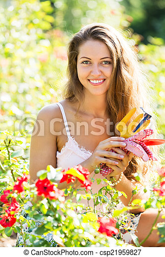 Woman gardening with roses - csp21959827