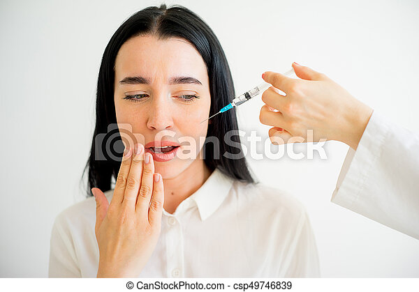 Woman gets facial injection - csp49746839