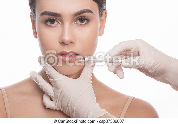 Woman getting beauty facial injections - csp37586007