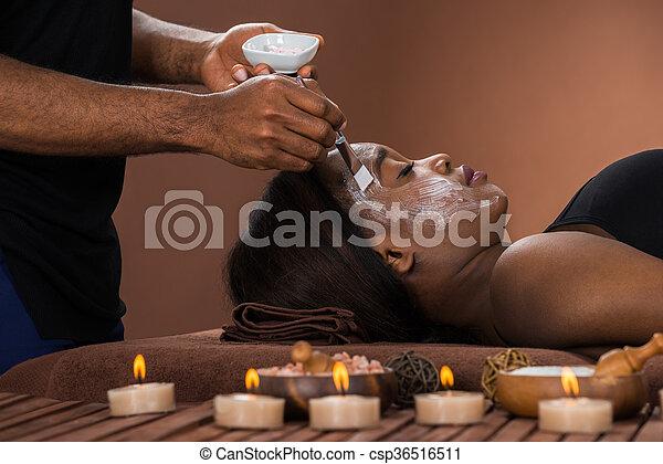 Woman Getting Facial Mask At Spa - csp36516511