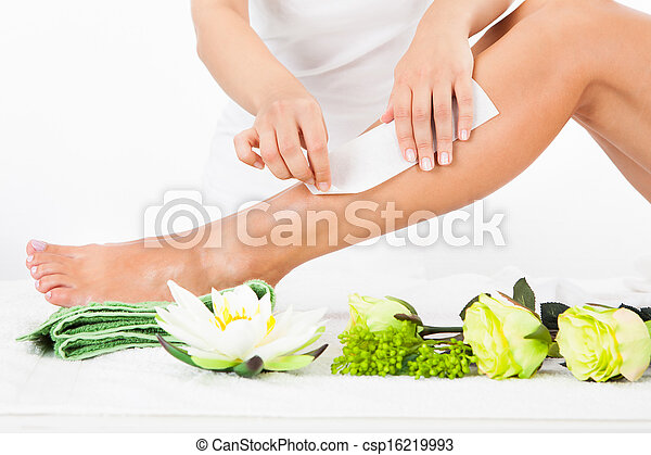 Woman Getting Legs Waxed - csp16219993
