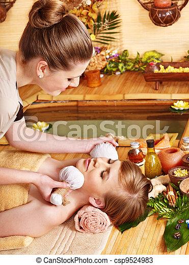 Woman getting thai herbal massage ball. - csp9524983