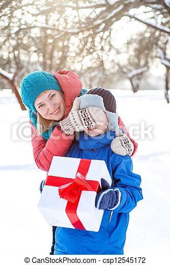 woman gives a Christmas present boy - csp12545172