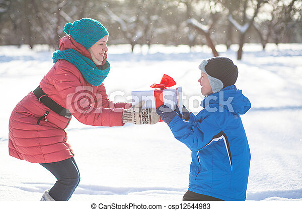 woman gives a Christmas present boy - csp12544983