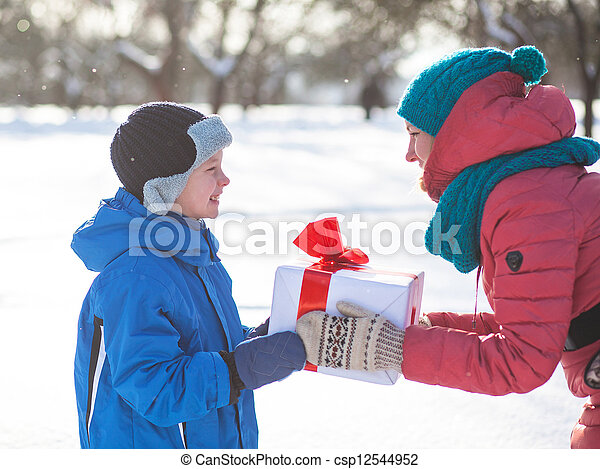 woman gives a Christmas present boy - csp12544952