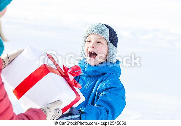 woman gives a Christmas present boy - csp12545050