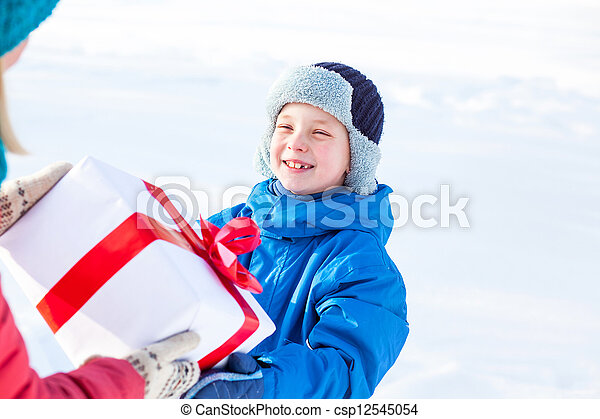 woman gives a Christmas present boy - csp12545054
