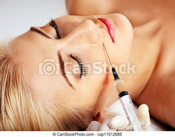 Woman giving botox injections. - csp11512685