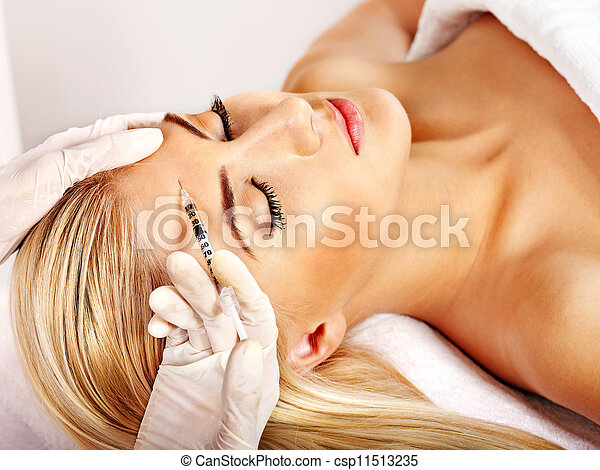 Woman giving botox injections. - csp11513235