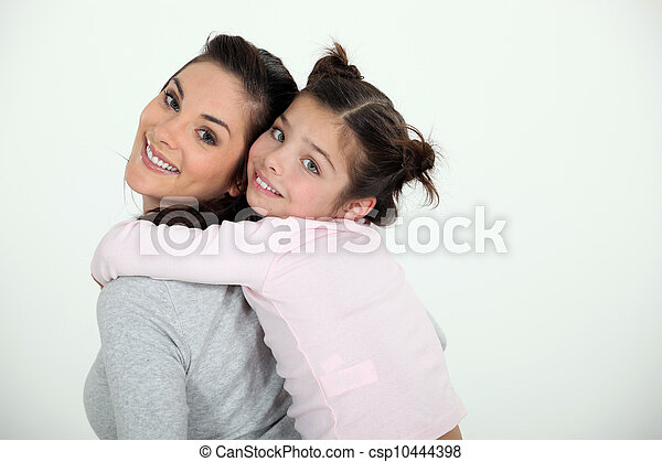 Woman giving her daughter a piggy back ride - csp10444398