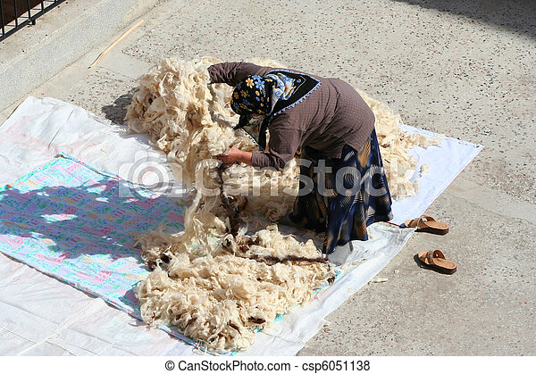 Woman giving wool an airing - csp6051138