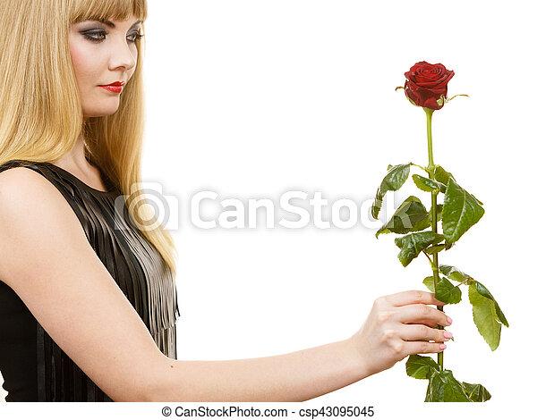 Woman gorgeous girl dark makeup holds rose flower - csp43095045
