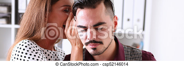 Woman gossip whispers in the ear of news to a man - csp52146014
