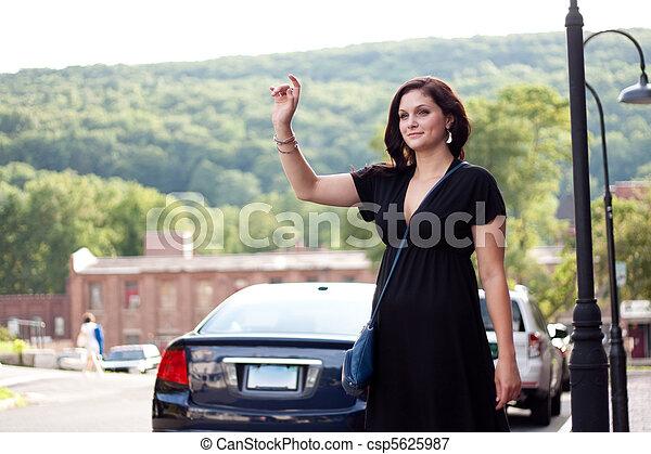Woman Hailing a Taxi Cab - csp5625987