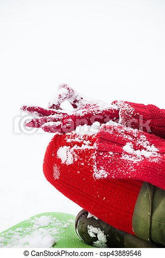 woman hand closeup in lotus yoga position in snow woman