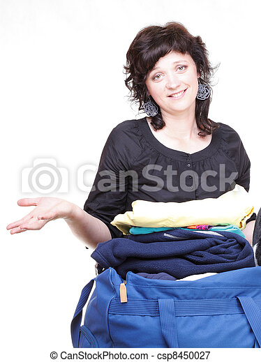 woman hand crammed full of clothes and shoulder bag isolated - csp8450027
