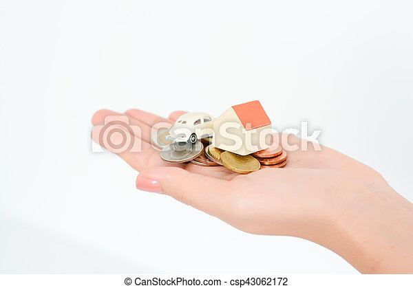 Woman hand holding a toy house and a car suggesting family investments