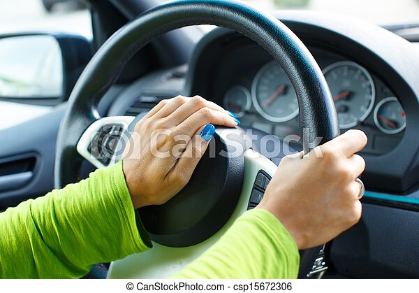 Woman hand pressing on a car horn  - csp15672306