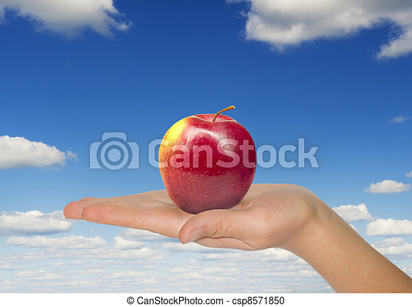 Woman hand with red apple - csp8571850