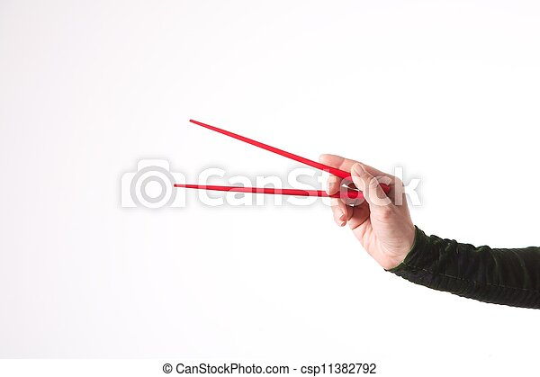 woman hand with red chopsticks - csp11382792