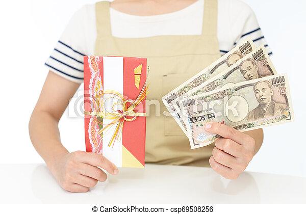 Woman hands hold money - csp69508256