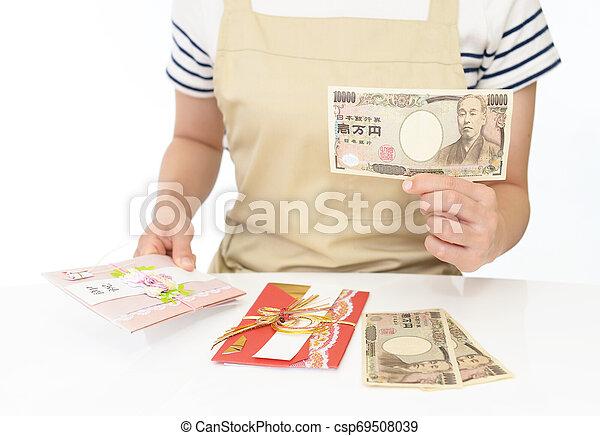 Woman hands hold money - csp69508039