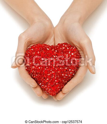 woman hands holding heart - csp12537574