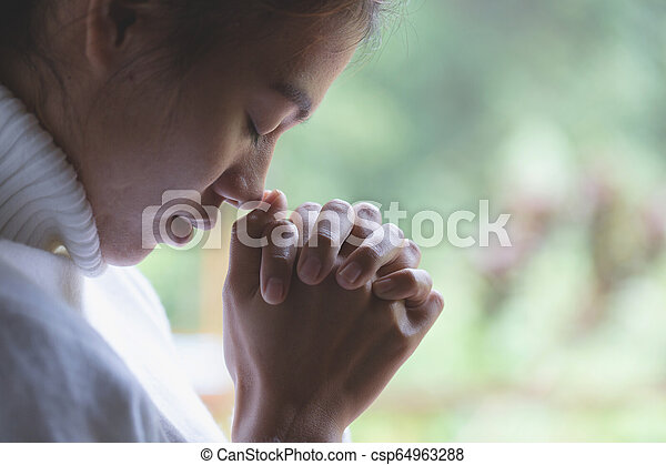 woman hands praying to god with the bible  Woman Pray for god blessing to  wishing have a better life  Christian life crisis prayer to god