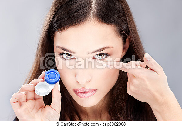 woman have contact lens on her finger - csp8362308