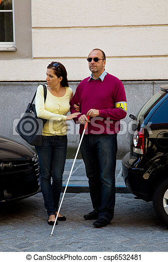 Woman helps blind man on the street - csp6532481