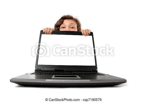 Woman Hiding Behind a Laptop - csp7190579