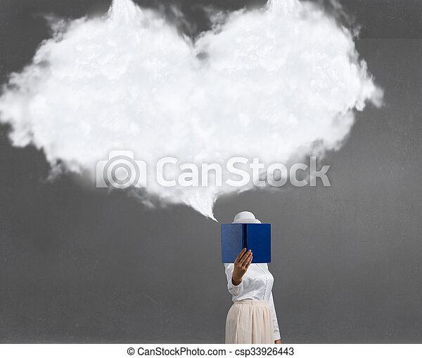 Woman hiding face behind book - csp33926443