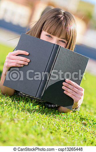 Woman Hiding Face With Book - csp13265448