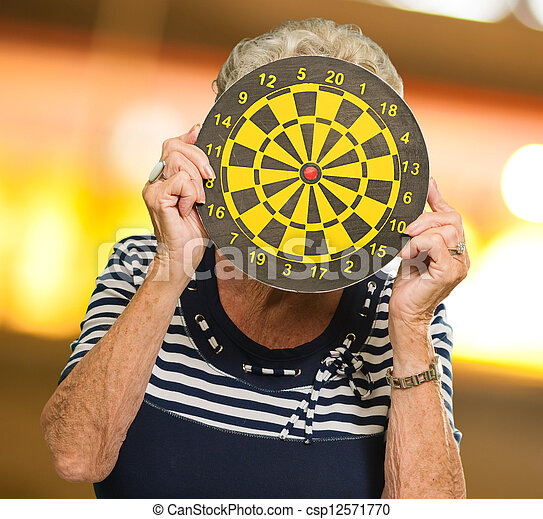 Woman Hiding Her Face With Dart Board - csp12571770
